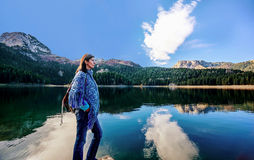 Young woman admires beautiful panorama of Black Lake ( Crno jeze Stock Photo