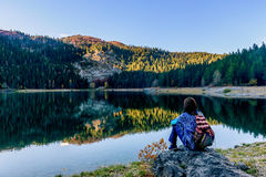 Young woman admires beautiful panorama of Black Lake ( Crno jeze Royalty Free Stock Photo
