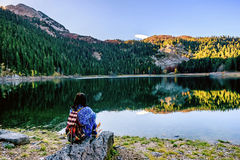 Young woman admires beautiful panorama of Black Lake ( Crno jeze Stock Photography