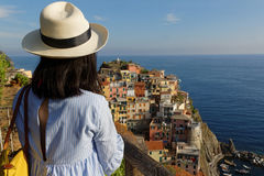 A young woman admires Manarola landscape Stock Photography