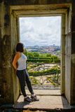 Young woman admires the old city landscape Stock Images