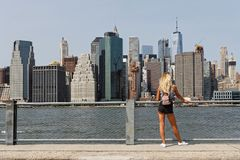 A young woman admires the view of Manhattan skyline Stock Photos