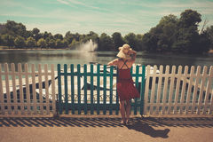 Young woman admiring boating lake Royalty Free Stock Photos