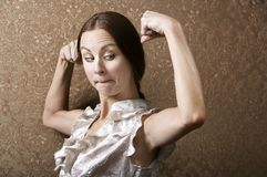 Young Woman Admiring Her Bicep Royalty Free Stock Photos