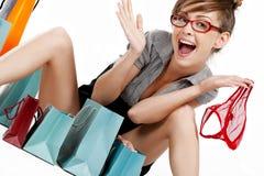 Young woman admiring her shopping Stock Photos