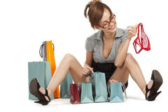 Young woman admiring her shopping Stock Images