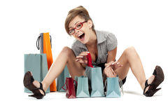 Young woman admiring her shopping Royalty Free Stock Photos