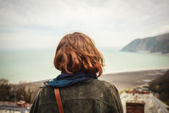 Young woman admiring the seaside view Royalty Free Stock Photography