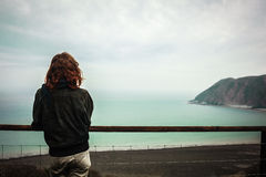 Young woman admiring the seaside view Stock Image