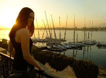 Young woman admiring sunset over the Nile river, Luxor Stock Photos