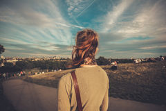 Young woman admiring view from a hill Stock Photography