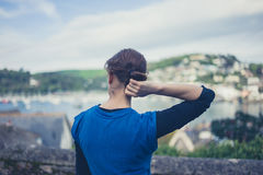 Young woman admiring view of seaside town Royalty Free Stock Photography