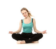 Young woman in advanced sitting yoga pose Stock Images