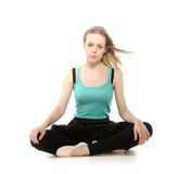 Young woman in advanced sitting yoga pose Stock Photo