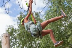 Young woman in adventure park summer challenge. Young woman in adventure park challenge concept Stock Image