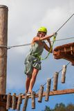 Young woman in adventure park summer challenge. Young woman in adventure park challenge concept Royalty Free Stock Image
