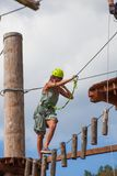 Young woman in adventure park summer challenge. Young woman in adventure park challenge concept Royalty Free Stock Photo