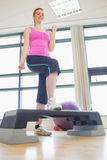 Young woman at aerobics class in gym Royalty Free Stock Photography