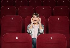 Young woman afraid of the movie Stock Photo