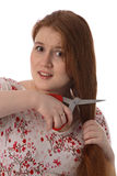 The young woman is afraid to cut hair royalty free stock photos