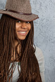 Young woman with African braids. Young black woman with African braids in a hat Royalty Free Stock Image