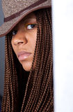 Young woman with African braids. Portrait of a young woman with African braids and hat Stock Photo