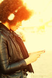 Young woman with afro hair cut and headphones Stock Photography