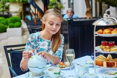 Young woman at the afternoon tea ceremony Stock Photos