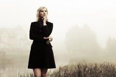 Young woman against an autumn haze Stock Photo