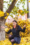 Young woman against autumn nature Stock Image