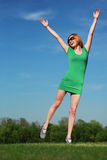 Young woman against blue sky. Shot of an attractive young woman outdoors Royalty Free Stock Images