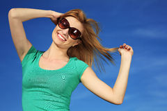 Young woman against blue sky Stock Image