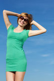 Young woman against blue sky. Shot of an attractive young woman outdoors Stock Image