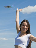 Young woman against the blue sky. Happy beautiful girl against the blue sky Stock Photo