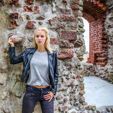 Young woman against brick wall Royalty Free Stock Photography