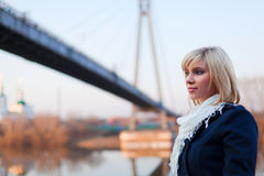 Young woman against a bridge. Stock Photography