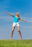 The young woman against the dark blue sky Stock Photography