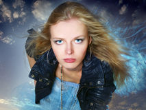 Young woman against the dark sky with long  hair Royalty Free Stock Images