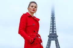 Young woman against Eiffel tower in Paris, France Stock Photography