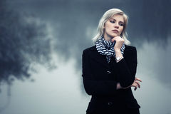 Young woman against a foggy landscape Royalty Free Stock Image