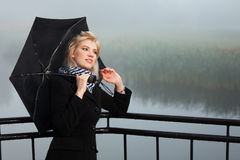 Happy young fashion woman with umbrella outdoor Stock Photo