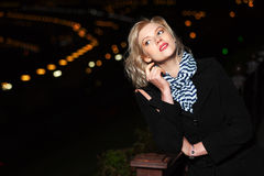 Young woman against a night city Royalty Free Stock Photography