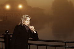 Young woman against a night foggy landscape Royalty Free Stock Photography