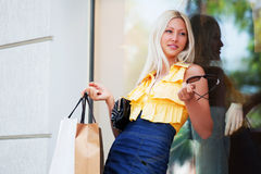 Happy young fashion woman with shopping bags Royalty Free Stock Photography