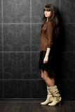 Young woman against wall with pattern Royalty Free Stock Images