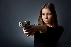 The young- woman agent. The young woman-agent on a black background Royalty Free Stock Photo