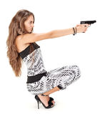 Young woman aiming with black pistol Royalty Free Stock Photography