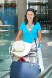 Young woman in the airport Stock Photography