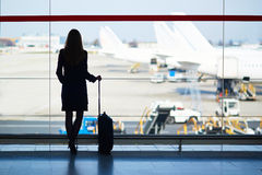 Young woman in the airport Royalty Free Stock Photography