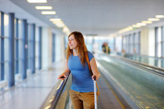 Young woman at the airport Stock Images